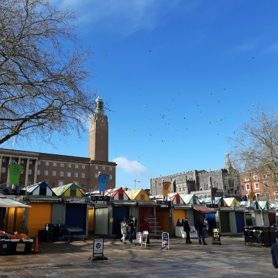 A lovely spring blue sky over Norwich Market with the resident pigeons enjoying the weather!